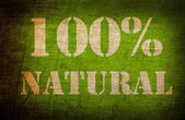 100 percent natural sign on old linen background — Stock Photo