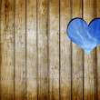 Hole - heart in a wooden wall  — Stock Photo