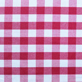 Lined red and white dining cloth background — Stock Photo