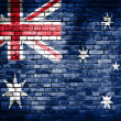 Flag of Australia painted on a grunge brick wall — Stockfoto