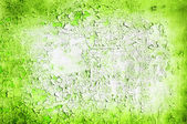 Green wall with old cracked paint — Stock Photo
