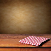 Wooden table and tablecloth — Stock Photo
