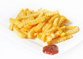 Fries with barbecue sauce — Stock Photo