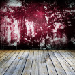 Empty old grungy room with red wall — Stock Photo