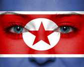North Korea flag painted on woman face — Stock Photo