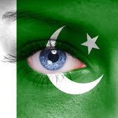 Pakistan flag painted on woman face — Stock Photo