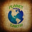 Earth planet symbol on grunge background — Stock Photo