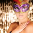 Beautiful young woman in carnival mask — Stock Photo