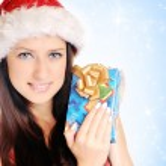 Christmas girl with gift — Stock Photo