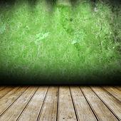 Dunklen raum mit grüne wand mit muster darauf — Stockfoto