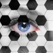 Soccer ball pattern on human face — Stock Photo