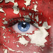 Red cracked paint on woman face — Stock Photo