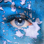 Blue cracked paint on woman face — Stock Photo