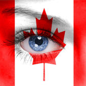 Human face painted with flag of Canada — Stock Photo