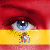 Spain flag painted on face — Stock Photo