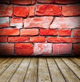 Empty room, red brick wall, wooden floor — Stock Photo