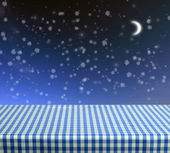 Empty table with moon and snowflakes — Stock Photo