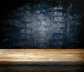 Empty table and dark blu — Stockfoto