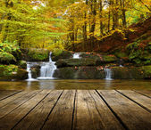 Autumn waterfall background with empty table — Stock Photo