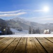 Empty wooden deck table with winter background — Stock Photo