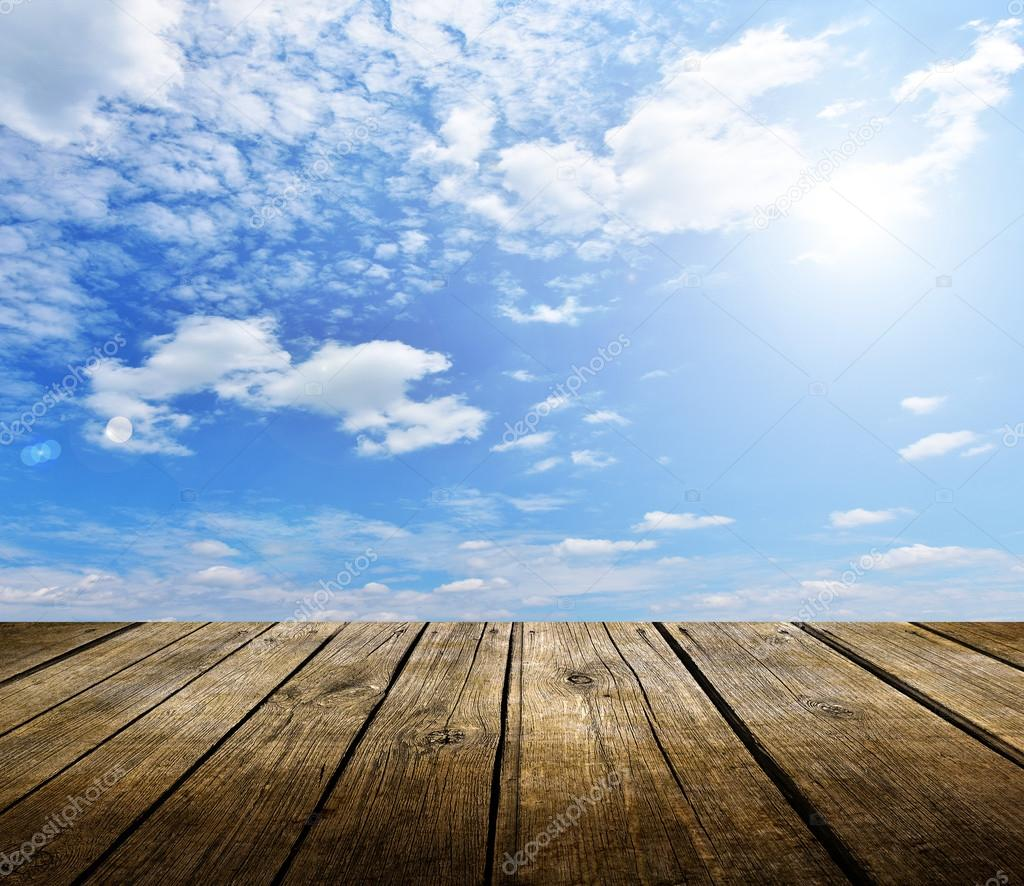 Empty Wooden Deck Table With Blue Sky In Background