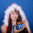 Girl in santa claus costume — Stock Photo