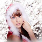 Girl in santa claus costume — Стоковое фото