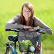 Woman with bicycle — Stock Photo #46306005