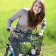 Woman with bicycle — Stock Photo #46306159