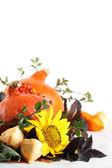 Autumn decoration with hokkaido pumpkins and sunflowers — Stock Photo