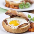 Baked eggs and bacon — Stock Photo #21670389