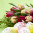 Flowery Easter eggs and tulips - Stock Photo