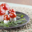Tomato and egg fly agaric mushrooms — Stock Photo
