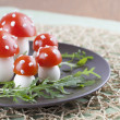 Tomato and egg fly agaric mushrooms - Stock Photo
