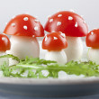 Tomato and egg fly agaric mushrooms — Stock Photo #25555341