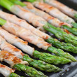 Grilled prosciutto wrapped asparagus — Stockfoto #26991581
