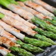 Grilled prosciutto wrapped asparagus — Stock Photo #26991581