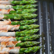 图库照片: Grilled prosciutto wrapped asparagus