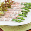Prosciutto wrapped asparagus — Stock Photo