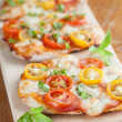 Mini pizzas with mozzarella and cherry tomatoes — Stock Photo
