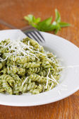 Fusilli with pesto and parmesan — Stock Photo