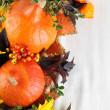 Autumn decoration with hokkaido pumpkins and sunflowers — Stock Photo