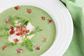 Arugula cream soup with sour cream and bacon — Stock Photo