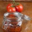 Stock Photo: Dried tomatoes in jar