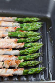 Grilled prosciutto wrapped asparagus — Stock Photo