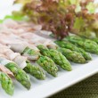 Prosciutto wrapped asparagus — Stockfoto