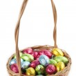 Chocolate eggs in a basket on white — Stock Photo #39687161