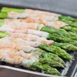 Grilled prosciutto wrapped asparagus — ストック写真