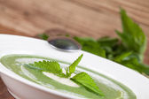 Nettle cream soup with sour cream — Stock Photo