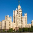 Постер, плакат: Stalin skyscraper against cloudless blue sky